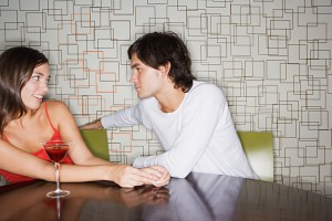 Man moving closer to woman in a bar