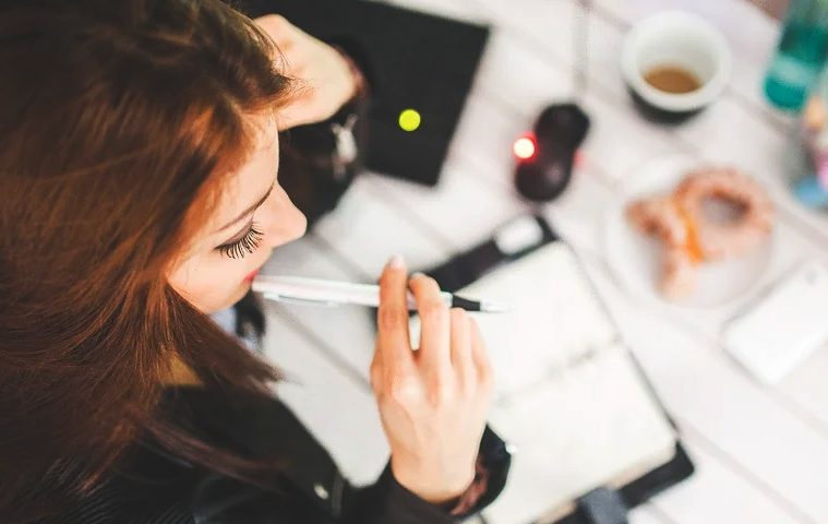 Working Woman Biting Pen